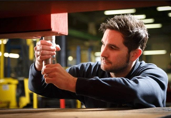 Esprit Automation technician repairing a CNC plasma cutter